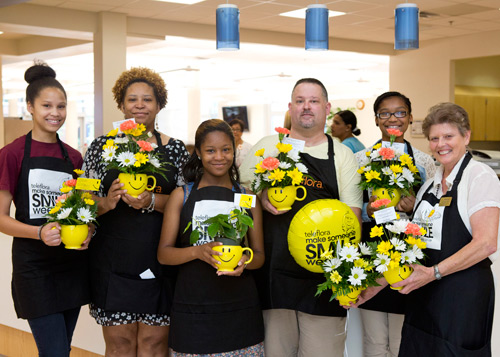 Recently, about 180 residents of Lake Taylor Transitional Care Hospital had their days made by a dayellow smiley face flower vase.