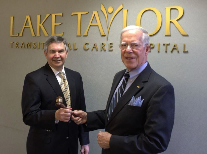 David Durham receiving gavel from Edward Lilly, MD